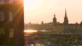 Backlight, view of Stockholm, sweden, during the summer. Stockholm`s cityscape, backlight. In the foreground, we can see construction sites that show that the stock footage