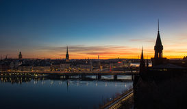 Stockholm skyline at dawn. Silhouetted buildings in central Stockholm against sunrise background. Sweden Royalty Free Stock Photography