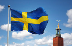 Stockholm stad och den svenska flaggan Royaltyfri Fotografi