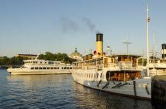 Stockholm steamer and ferry. Passenger steamer S/S Blidösund and saltsjön a summer evening in Stockholm harbour, Skeppsbron, Gamla stan. A modern Waxholmsboat Royalty Free Stock Images