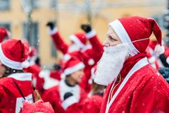 Man dressed up as santa participates in charity event Stockholm Santa Run in Sweden Royalty Free Stock Photos