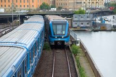 Metro trains on a bridge in a cloudy day, Stockholm Royalty Free Stock Photo