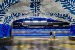 People standing in front of a moving train Stockholm metro or tu royalty free stock images