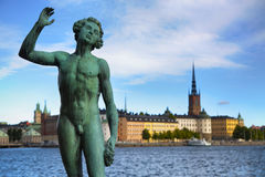 STOCKHOLM, SWEDEN - AUGUST 20, 2016: Song statues near Stockholm. City Hall  Stadshuset  and View of Gamla Stan from Stockholm City Hall in Stockholm, Sweden on Royalty Free Stock Image