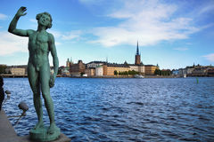 STOCKHOLM, SWEDEN - AUGUST 20, 2016: Song statues near Stockholm. City Hall Stadshuset and View of Gamla Stan from Stockholm City Hall in Stockholm, Sweden on Stock Photography