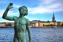 STOCKHOLM, SWEDEN - AUGUST 20, 2016: Song statues near Stockholm. City Hall  Stadshuset  and View of Gamla Stan from Stockholm City Hall in Stockholm, Sweden on Royalty Free Stock Images