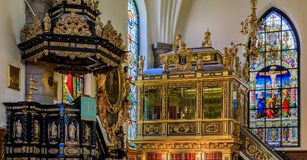 Stained glass windows and interior of the German Church in Stock. Stockholm, Sweden - August 14, 2017: Stained glass windows, the pulpit and the `king`s gallery royalty free stock photos