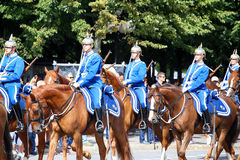 STOCKHOLM, SWEDEN - AUGUST 20, 2016: Swedish Royal Guards on hor. Se in blue uniforms in the dayly procession on Stromgatan street in Stockholm, Sweden on August Royalty Free Stock Photo