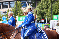 STOCKHOLM, SWEDEN - AUGUST 20, 2016: Swedish Royal Guards on hor. Se in blue uniforms in the dayly procession on Stromgatan street in Stockholm, Sweden on August Stock Photos