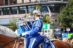 STOCKHOLM, SWEDEN - AUGUST 20, 2016: Swedish Royal Guards on hor. Se in blue uniforms in the dayly procession on Stromgatan street in Stockholm, Sweden on August Royalty Free Stock Images