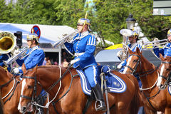 STOCKHOLM, SWEDEN - AUGUST 20, 2016: Swedish Royal Guards on hor. Se in blue uniforms in the dayly procession on Stromgatan street in Stockholm, Sweden on August Stock Photo