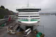 A tourist bus leaves the hold of a sea cruise ferry. The terminal of the company `Viking Line` Stock Photography