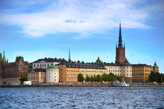 STOCKHOLM, SWEDEN - AUGUST 20, 2016: Tourists boat and View of G. Amla Stan from Stockholm City Hall  Stadshuset  in Stockholm, Sweden on August 20, 2016 Stock Image