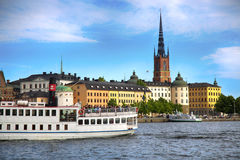 STOCKHOLM, SWEDEN - AUGUST 20, 2016: Tourists boat and View of G. Amla Stan from Stockholm City Hall  Stadshuset  in Stockholm, Sweden on August 20, 2016 Stock Photo