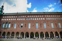 STOCKHOLM, SWEDEN - AUGUST 20, 2016: Tourists walk and visit Sto. Ckholm City Hall  Stadshuset , Venetian-style colonnade that divides the City Hall in Stockholm Stock Photos