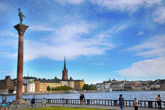 STOCKHOLM, SWEDEN - AUGUST 20, 2016: Tourists walk and visit Sto. Ckholm City Hall  Stadshuset  and View of Gamla Stan in Stockholm, Sweden on August 20, 2016 Royalty Free Stock Image