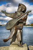 STOCKHOLM, SWEDEN - AUGUST 19, 2016: View of Evert Taube monumen. T with guitar on Gamla stan in Stockholm, Sweden in Stockholm, Sweden on August 19, 2016 Royalty Free Stock Image