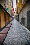 STOCKHOLM, SWEDEN - AUGUST 20, 2016: View of narrow street and c. Olorful buildings, Kakbrinken street located in Gamla Stan, old town in central Stockholm Royalty Free Stock Images