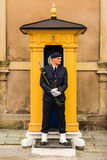 STOCKHOLM, SWEDEN -CIRCA 2016 - A guard stands stationary at his post at the Royal Palace which is in the old town stock photography