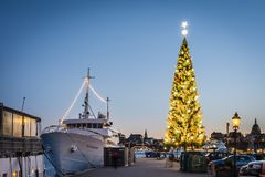 The Kinnevik traditional large Christmas tree at Skeppsbron, Stockholm. Known as the tallest Christmas tree in the world. STOCKHOLM, SWEDEN - DECEMBER 27, 2016 stock images