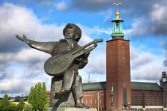 Stockholm, Sweden. Evert Taube monument on Gamla and City Hall Stan in Stockholm, Sweden Stock Photos