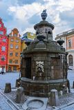 A water pump at Stortorget in  Stockholm. Stockholm, Sweden - January 05th 2015: Stortorgsbrunnen - a water pump at Stortorget in Gamla Stan, Stockholm Royalty Free Stock Photography