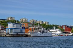 Floating homes and boats docked at Pampas Marina, Stockholm, Sweden royalty free stock photos