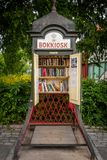 Front view of a steel vintage traditional phone booth made into a small public library in Stockholm Sweden. stock photography