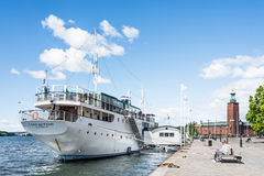 STOCKHOLM, SWEDEN - JULY 18, 2017: View over Lady Hutton ship with City Hall in the background, on sunny summer day in Stockholm Royalty Free Stock Images