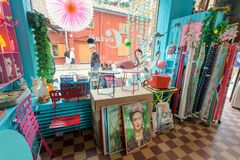 Classic Swedish restaurant, bar and waterhole with wooden furniture and eating visitors. STOCKHOLM, SWEDEN - JUN 14, 2018: Posters Frida Kahlo in boho style Stock Photos