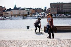 Urban life. Cool skateboarder outdoors. Stockholm, Sweden - June 10, 2017 : Urban life. Cool skateboarder outdoors Scandinavian guy performing a trick with his Royalty Free Stock Photo