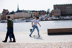 Urban life. Cool skateboarder outdoors Stock Photos