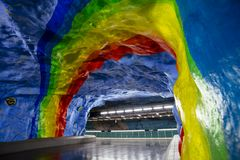 STOCKHOLM, SWEDEN - March 5, 2017: Underground metro Stadion sta. Tion with rainbow design painting in Stockholm, Sweden dedicated to olympic games in Sweden Stock Photo