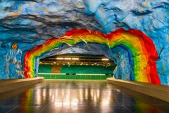 Colorful rainbow painting on the wall of the main platform of Stadion metro station in Stockholm, Sweden. LGBTQ rainbow colors. Stockholm, Sweden - May 26, 2019 stock photography