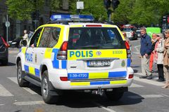 Police Car by deployment in Stockholm City. STOCKHOLM, SWEDEN - MAY 15: Police Car by deployment in Stockholm City - closes marching royal orchestra and ensures Stock Photos