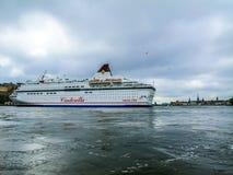 Stockholm / Sweden - May 15 2011: Viking Line ship Cinderella turning and leaving port of Stockholm stock photos