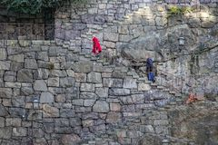 Old couple walk up for old stone stairs on the island Södermalm, Stockholm. stock images