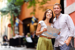 Stockholm tourists couple with map in Gamla Stan stock images