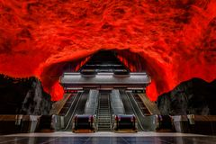 Stockholm metro or tunnelbana station Solna Centrum with fire li. Stockholm underground metro or tunnelbana station Solna Centrum with fire like wall designs stock photos