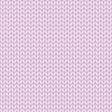 桃红色编织了无缝的样式,编织stockinette针 免版税库存照片