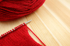 Stockinette stitch on knitting needle with red wool Royalty Free Stock Image