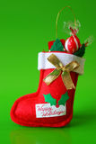 Stocking. Red Christmas stocking decoration filled with candy Royalty Free Stock Photos