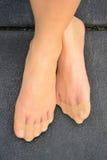 Stocking on feet, female wear stockings. Stock Photos