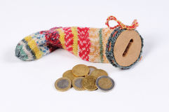Stocking for saving with Euro bills and Euro Coins stock photos