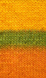 Stocking stitch in yellow, green and orange background Royalty Free Stock Photo