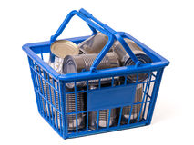 Stocking Up on Canned food. Stocking on canned food, a shopping basket full of canned or tinned food royalty free stock photography