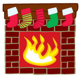 Stockings Hanging Over Mantle. Four Christmas stockings hanging over the fireplace mantle Royalty Free Stock Image