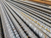 Stockpile of steel bars in construction site to execute reinforced concrete.  stock images