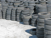 Stockpile of Used Tires. A stockpile of used tires ready to be resold royalty free stock photo