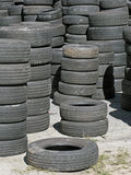 Stockpile of Used Tires. A stockpile of used tires ready to be resold Stock Image